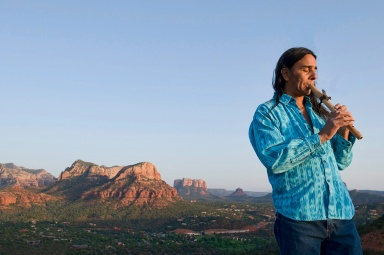 Rahelio (he only goes by the one name) leads spiritual journeys in  and around Sedona, Arizona.  Here he plays flute at Airport Mesa, site of a major vortex,  before leading a dream journey.
